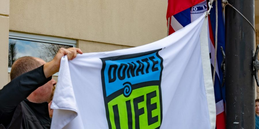 What is a Donate Life flag raising ceremony and what does it mean?